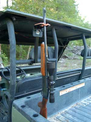 Gun grabber mounted in back of side by side