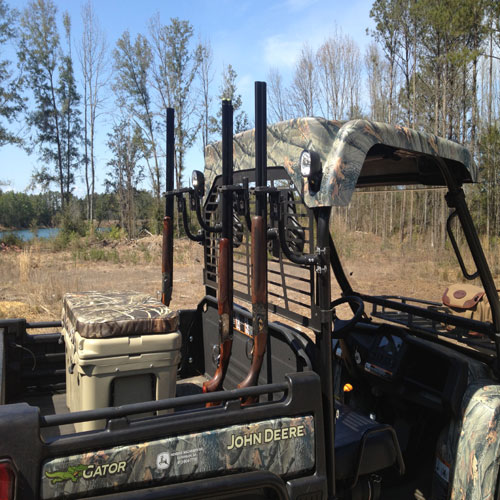 Military steel Over and Under shotguns mounted on a shooting cart
