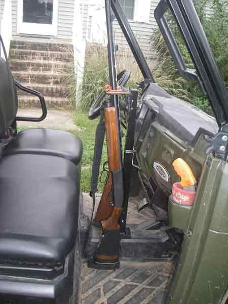 UTV Golf Cart Vertical Gun Rack mounted in a John Deere UTV