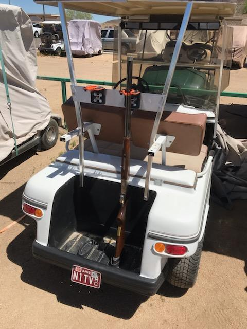 Over and Under shotguns mounted on golf cart