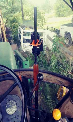 Tractor gun rack in enclosed combine