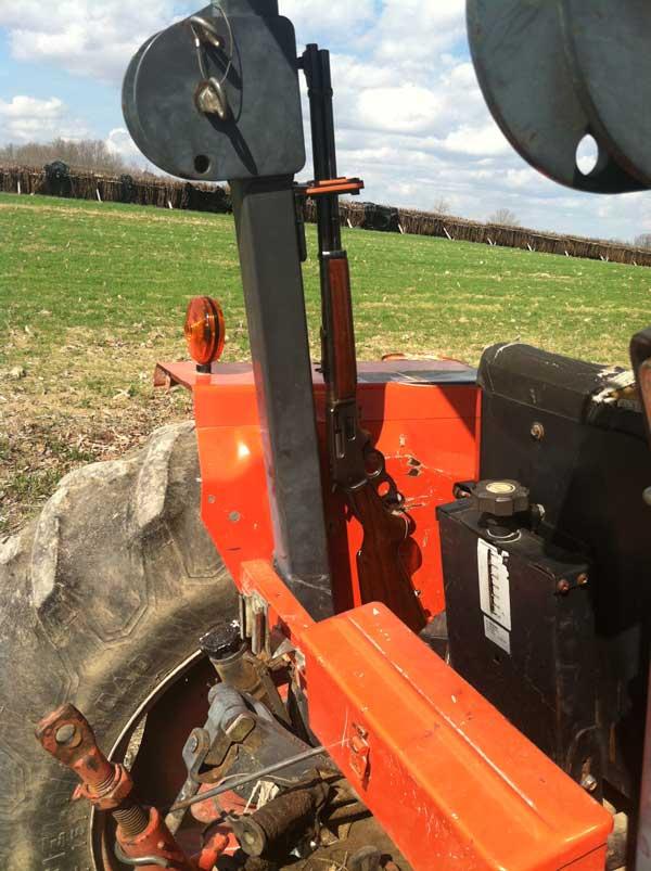 Military Grade Steel Gun Rack with Rubber Gun Butt mounted on farm tractor